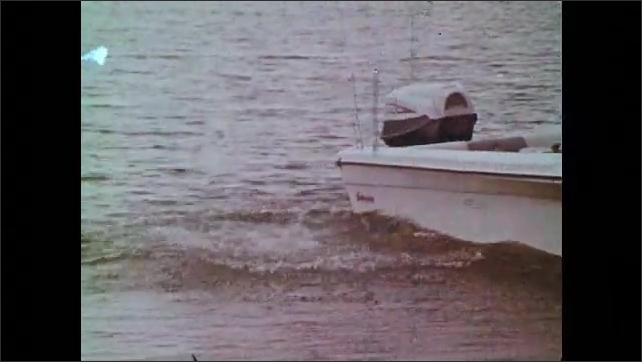 1970s: UNITED STATES: racing driver gets into car. Man hits metal pole on bench. Backward entry into water. Scuba diver on boat. Man prepares parachute