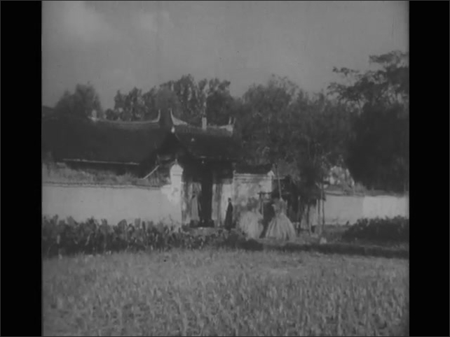 1940s: people walking into a home's courtyard, man working in fields