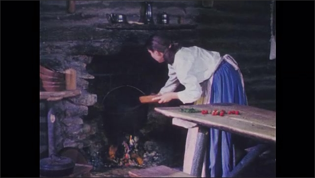 1950s: Mother stirs kettle over fire. Jam ingredients and preparation.