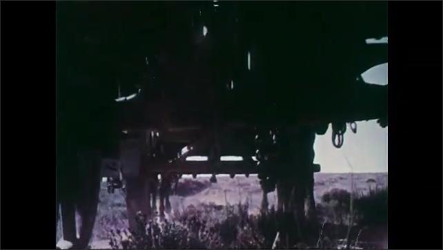 1950s: Mountain.  Wagon train travels along.  Prairie.