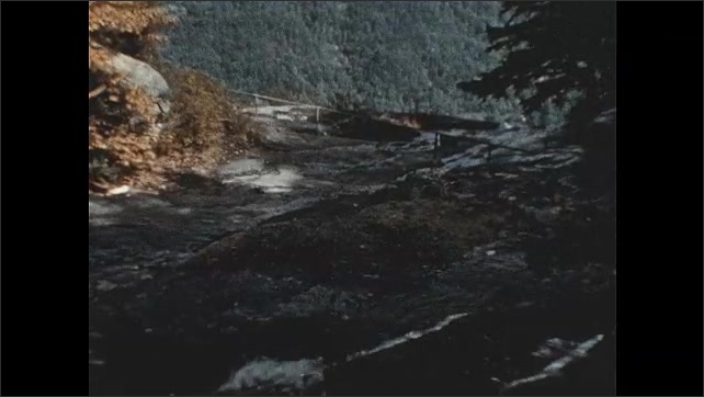 1950s: Water falls down mountain. Water flows into stream.