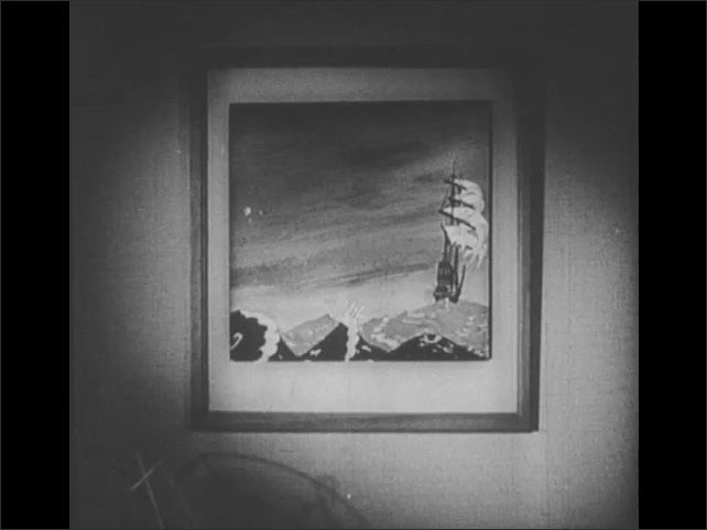 1940s: Doll turns fan toward painting of ship. Painting becomes animated: ship bobs on rough sea waters. Doll turns fan to papers, papers blow across room, girl jumps on bed. Christmas tree shakes.