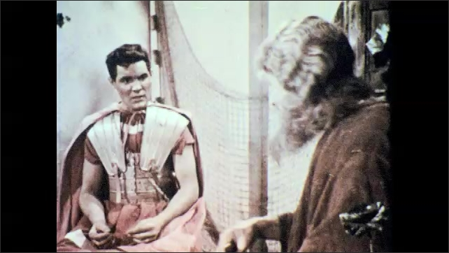 1950s: Man making net, man in armor enters. Man sits, men talk.