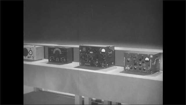 1950s: Signal generators on a table. Animation of waves traveling through a vacuum tube.