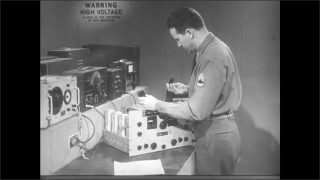 1950s: Man removes tubes from radio receiver. Man inspects tubes, places tubes back into radio receiver.
