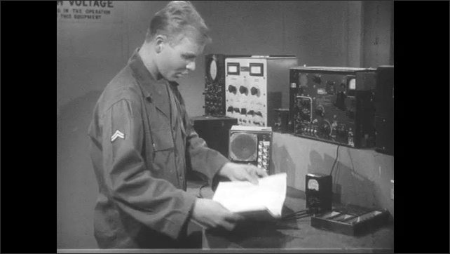 1950s: Man looks at booklet in lab. Man picks up piece of equipment in lab.