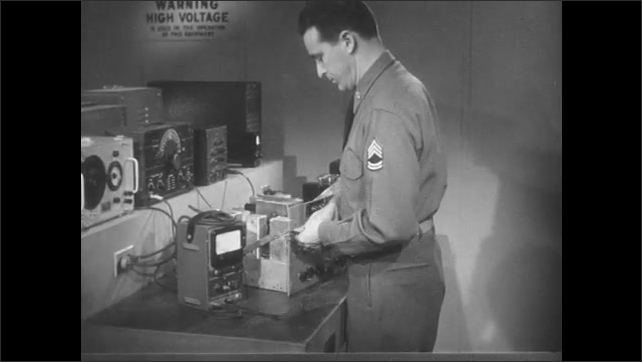 1950s: Man in lab, connects signal generator to receiver.