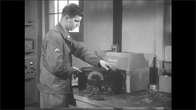 1950s: Man takes machine from box. Hand plugs in machine.