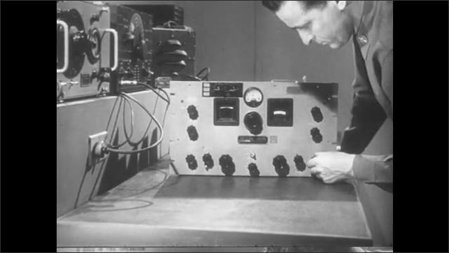 1950s: View of oscilloscope. Man adjusts generator in lab, zoom in on generator.