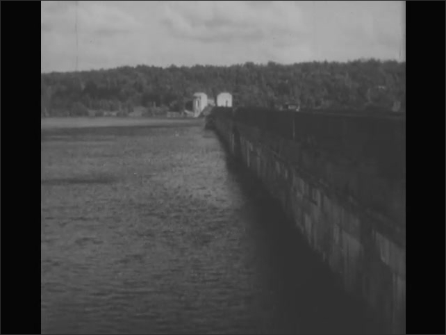 1940s: Animated line is drawn along horizon.  Reservoir.  Car drives across bridge.  Animated map shows how water travels from one area to another.