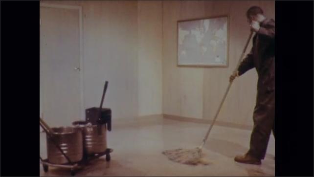1970s: Man mops floor. Man buffs floor.