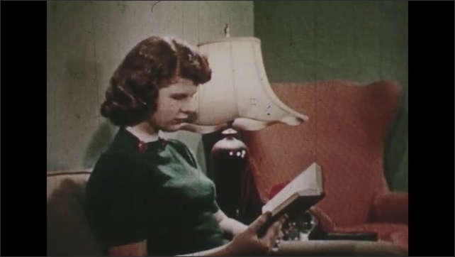 1950s: UNITED STATES: lady adjusts dress in mirror. Lady reads book in chair