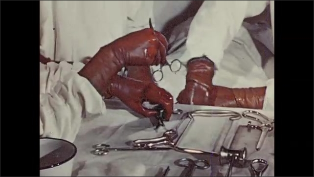 1950s: Doctors operate on patient, nurse hands doctors tools. Doctor walks out of operating room, removes cap. Nurse rolls patient out of operating room.