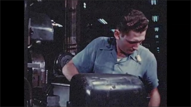 1950s: Men work in factory, operate machinery. Man removes apron, touches machine, grabs canes and walks away.