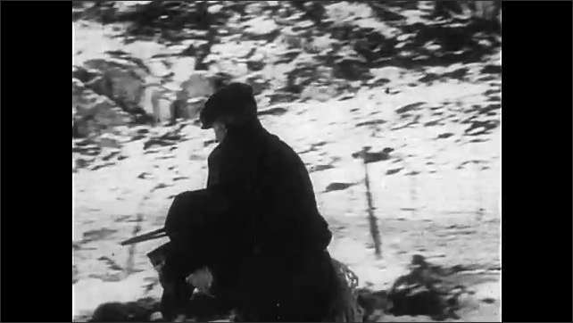 1940s: Smoke rises over snowy hill. Villager carries clothing from burning village. Soldiers adjust mobile radios on snowy hill. Soldier fires machine gun.