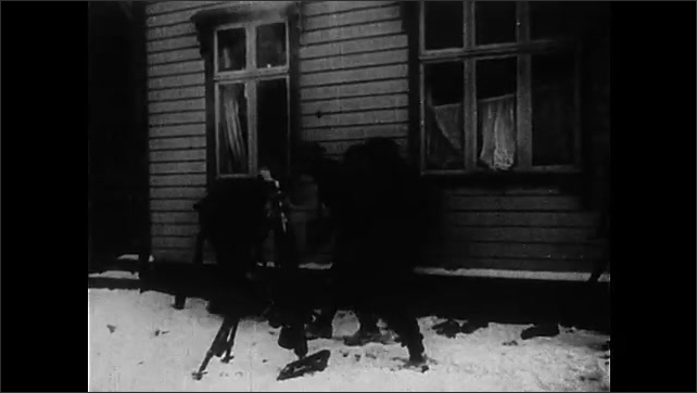 1940s: Town.  Soldiers load and shoot shells.  Enemy surrenders.