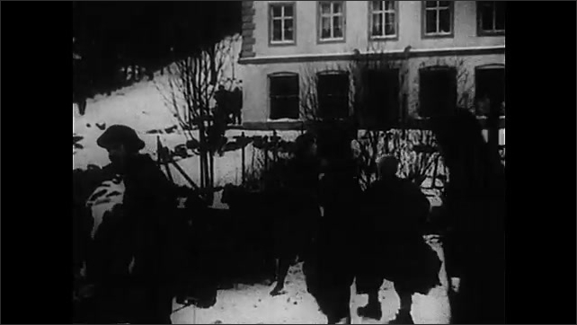 1940s: Fire destroys town.  Man runs with child on back.  Soldiers.  Women.  Street.