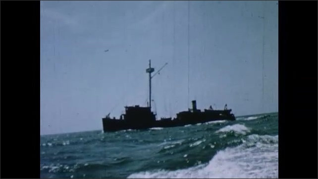 1950s: Fishing vessel bobs and rocks on rough waters in Chesapeake Bay.