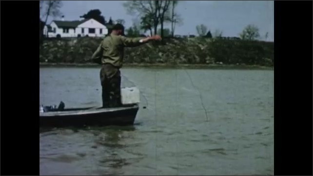 1950s: Men cast drift nets from small rowboat onto river.