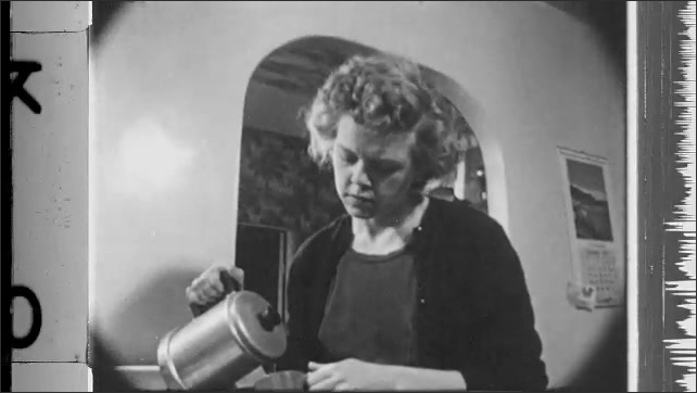 1950s: Dirty kitchen. Pots and pans on stove. Woman pours cup of coffee.
