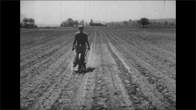 1930s: UNITED STATES: building by polluted stream. Man adds fertilizer to soil in field. Man fishing by river