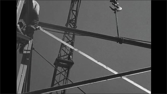 UNITED STATES 1950s: Men Working without Harnesses at Height on Construction Site
