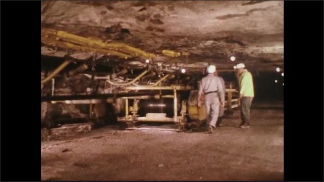 UNITED STATES 1970s : Three Workers Talking Together Inside Mine Shaft
