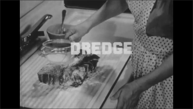 1950s: Woman wipes down meat with towel, sifts flour onto meat, smoothes it around.