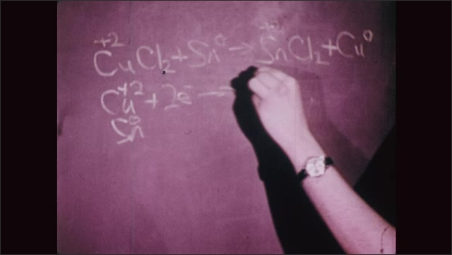 UNITED STATES 1970s: Reduction Reaction Written as an Equation on a Blackboard