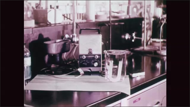 UNITED STATES 1970s: Boy Handling Chemical Solutions in a Chemistry Lab