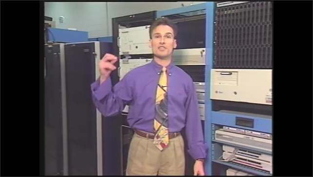 1990s: man in NASA's communication room at George C. Marshall Space Flight Center explaining the space link communication system, man explaining how to access space link from home computer