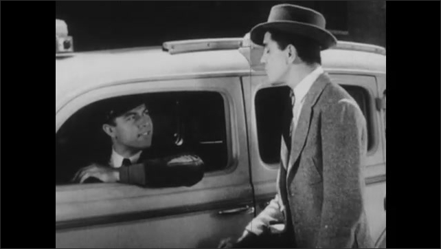1940s: UNITED STATES: men argue by car. Man chews gum. Man in hat. Lady speaks to cab driver. Man opens door of cab for lady.