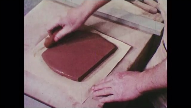 1940s: Man transfers slab of clay to paper, wipes surface with wet sponge, smoothes surface with rubber tool. Man places square template over clay.
