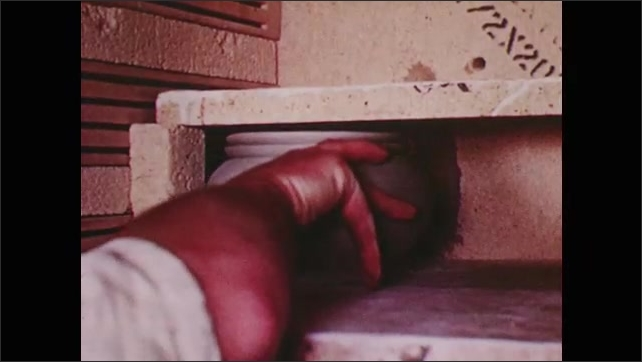 1950s: Shelf appears in kiln.  Man loads pottery.  Man stacks pottery and compares size to block.