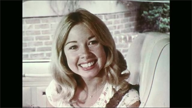 """UNITED STATES 1970s ?????A woman sits on the passenger's side of a car and mouths """"Hi""""."""