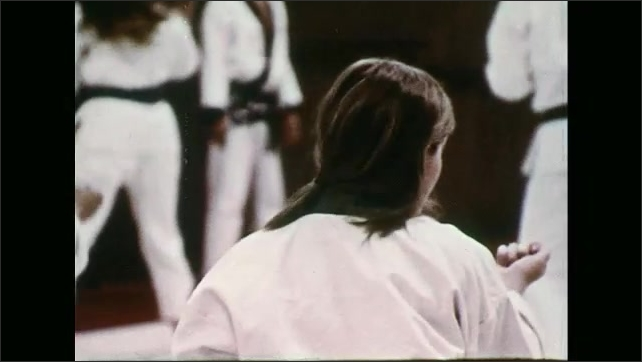 UNITED STATES 1970s ????? martial arts class practices kicking and punching at a martial arts school.
