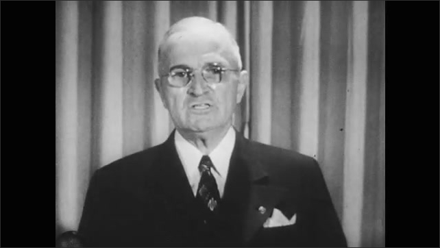 1950s: Korean people walk down road carrying belongings. President Harry Truman delivers address on television.