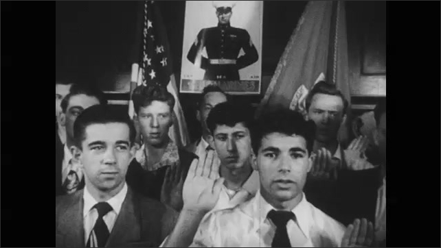 1950s: Men walk in line into Navy recruiting station. Men in group raise hands in pledge. Men sight pledge. Soldiers on Navy aircraft carrier. Docked aircraft carrier.