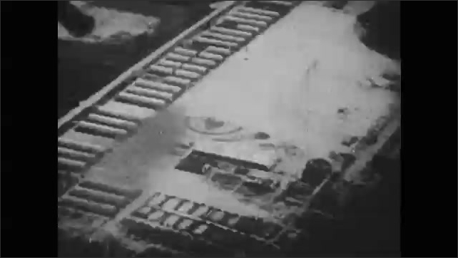 1950s: Flying over explosions and fire on road. Flying in jet in air. Explosions on ground below.