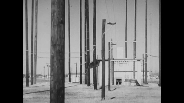 1940s: UNITED STATES: electrical poles and station. Plane in sky. Early Warning Aircraft.