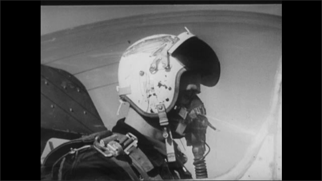 1940s: UNITED STATES: pilots in US Airforce. Pilot listens on headset. Authentication list code. Plane turns in sky.