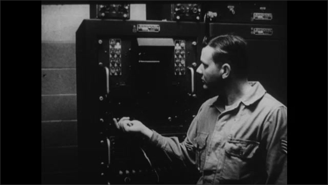 1940s: UNITED STATES: man writes on glass board. Man speaks on telephone Radar screen and reporting. Pilot in plane.