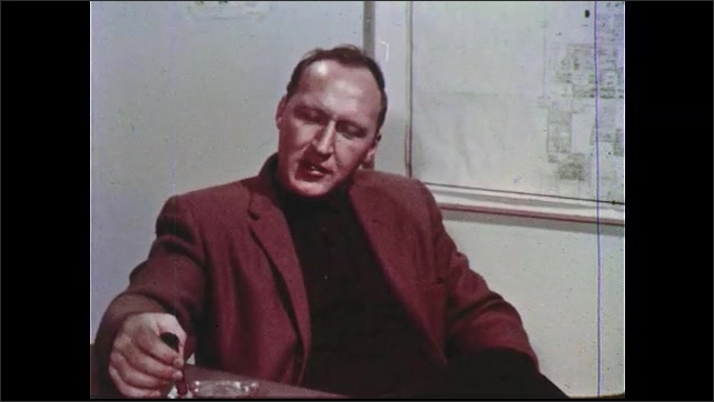 1960s: UNITED STATES: man smokes cigar in physician's room. Animated man talks in office