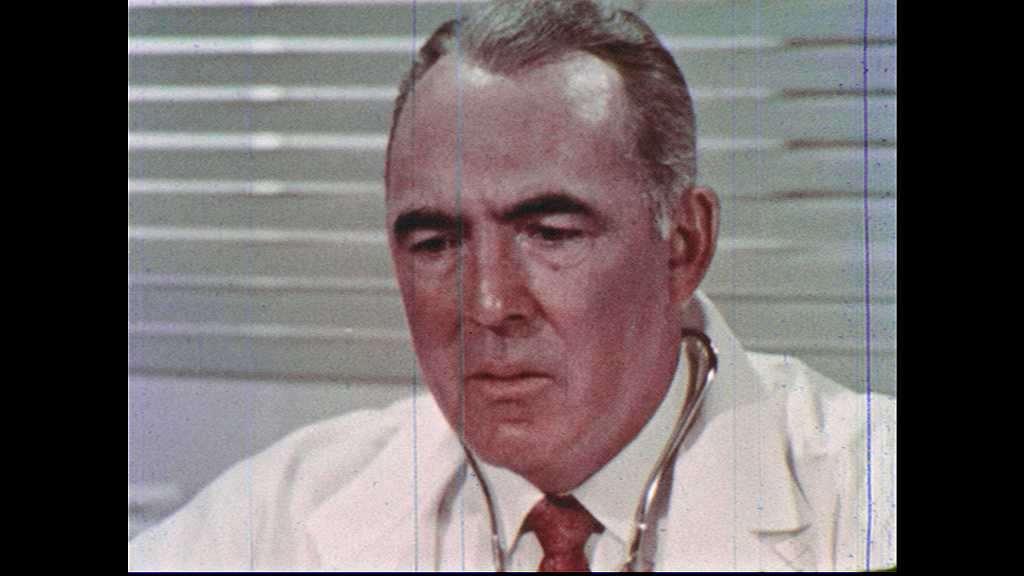 1960s: UNITED STATES: doctor thinks to self. Doctor looks worried.