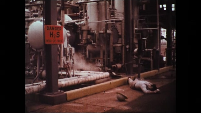 UNITED STATES 1970s: Worker Falls to Ground with Hydrogen Sulfide Poisoning at his Work Place