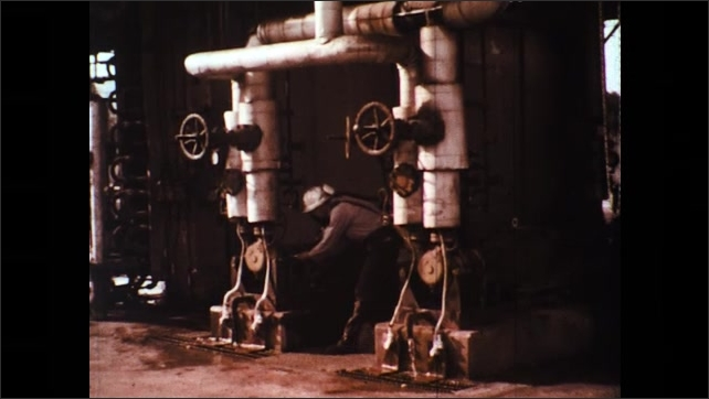 UNITED STATES 1970s: Operator Uses Detector to Determine Source of Hydrogen sulfide (H2S) Leak. Chemical Grains in Glass Turn Grey to Black