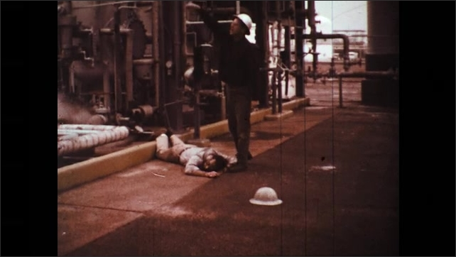 UNITED STATES 1970s: Rescuer Calls for Help as He Attempts Resuscitation on Hydrogen Sulfide Posoining Victim