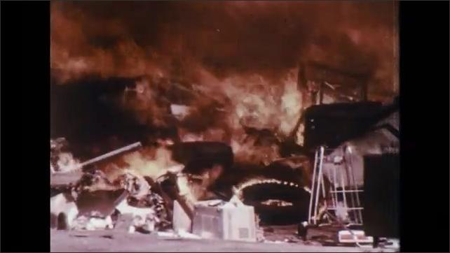 UNITED STATES 1970s: Trash burns at a dumpster.