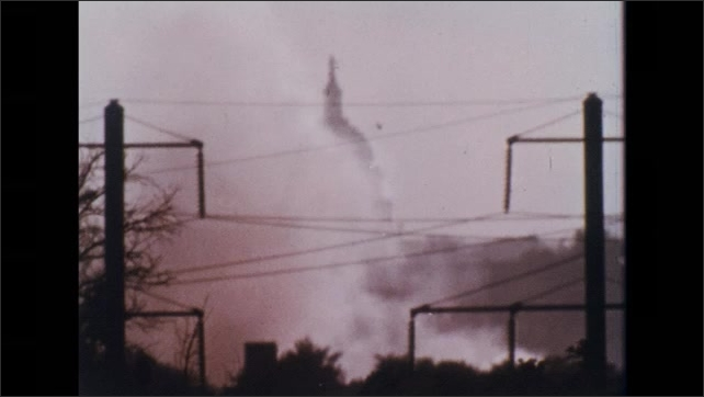 UNITED STATES 1970s: Introduction title to documentary with the US Capitol covered by smog.