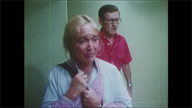 1980s: Doctor, mom and dad walk into room. Mom and dad walk through room, mom looks distraught. Mom and dad look down at dead son.